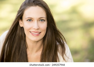 Portrait of a beautiful woman on green background