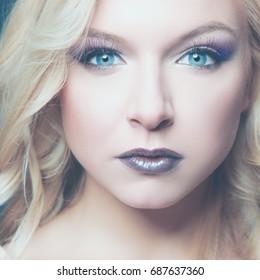 Portrait of beautiful woman, on grey background