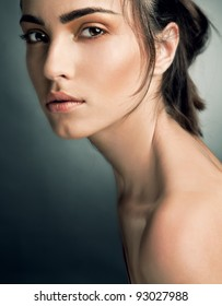 Portrait of beautiful woman on grey background