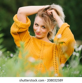 Portrait of beautiful woman on nature. The strength and health from nature
