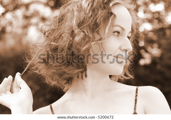 Portrait of beautiful woman on nature's background