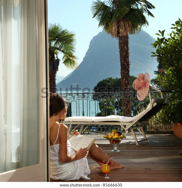 portrait of beautiful woman on the terrace of prestigious hotel.back view