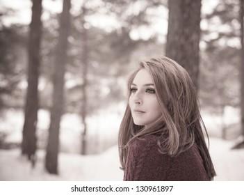 Portrait of a beautiful woman on winter park