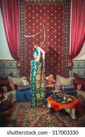 Portrait of a beautiful woman in oriental dress. Grace and beauty.