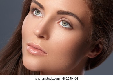 Portrait of beautiful woman with a perfect eyebrow shape and nude make-up