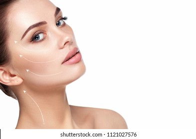portrait of beautiful woman with perfect skin of the face, with arrows on face, concept of lifting skin. Cosmetology, elastic and young skin of the face.