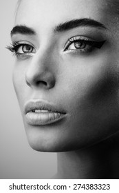 Portrait of beautiful woman with perfect skin and make-up. Black and white