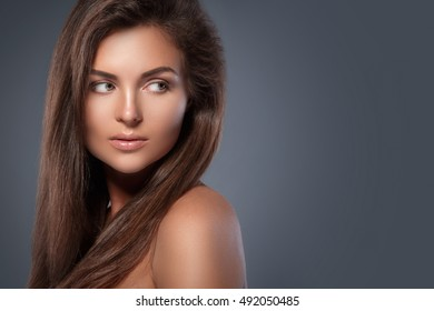 Portrait of beautiful woman with perfect skin and nude make-up
