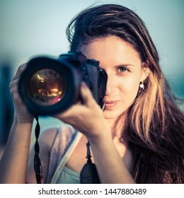 Portrait of a beautiful woman photographer with camera