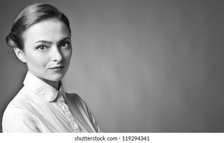 Portrait of beautiful woman posing on grey background