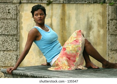 Portrait of a beautiful woman - posing on stone table