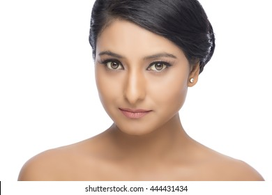 Portrait of beautiful woman with pretty face with clean skin on white background