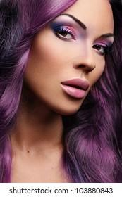 Portrait of beautiful woman in purple hair