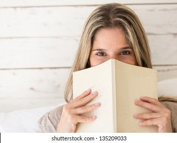 Portrait of a beautiful woman reading a book