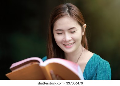 Portrait of beautiful woman reading book