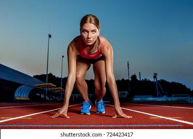 Portrait of beautiful woman ready to start running.