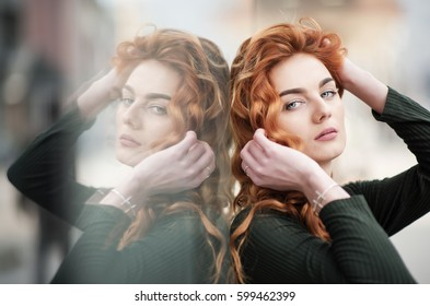 portrait of a beautiful woman with red curly hair and blue eyes