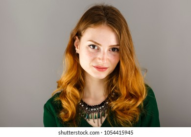 Portrait of a beautiful woman with red hair and freckles