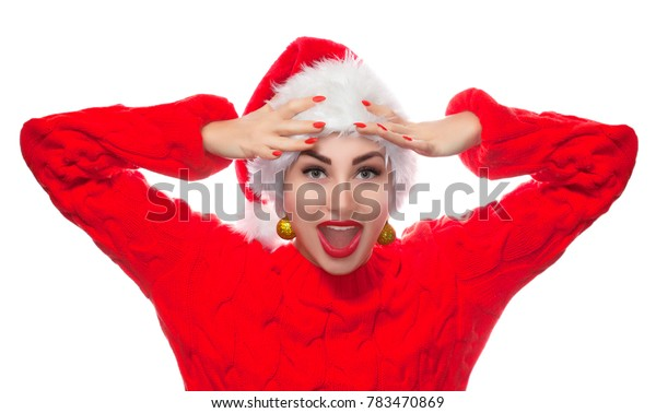 Portrait of a beautiful woman in a red hat and a sweater on a New Year theme.