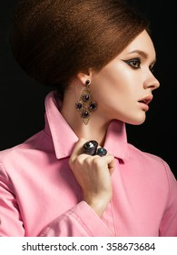 Portrait of Beautiful Woman with retro hairstyle and Clean Skin. Brigitte Bardot look. Old style make-up.