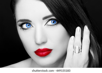 Portrait of beautiful woman with ring. Perfect makeup.