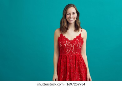 Portrait of beautiful woman in a sensuel red dress