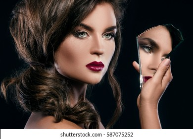 Portrait of beautiful woman with a shards of mirror