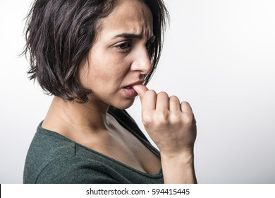 A Portrait of beautiful woman, she bites her fingers