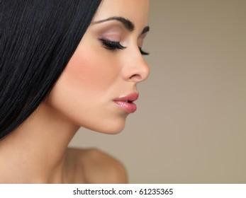 Portrait of beautiful woman, she has closed eyes