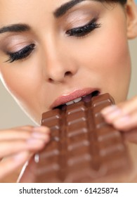 Portrait of beautiful woman, she holding chocolate bar