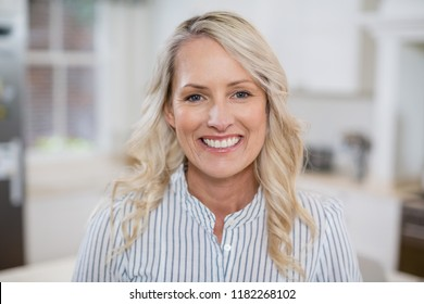 Portrait of beautiful woman smiling at home