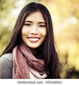 Portrait of a beautiful woman smiling on an autumn day.