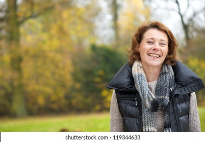 Portrait of a beautiful woman smiling in the park