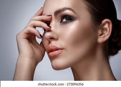 Portrait of beautiful woman with stylish makeup
