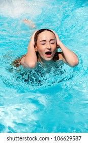 portrait of beautiful woman in summer in pool swimming holiday blue water