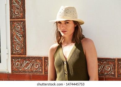 Portrait of beautiful woman in sunhat