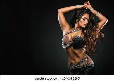 Portrait of beautiful woman, traditional ballydance dancer. Ethnic dance. Belly dancing. Tribal dancing.