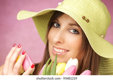 Portrait of beautiful woman with tulips