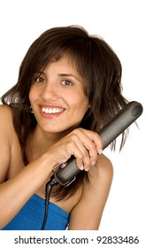 Portrait of beautiful woman using hair straighteners