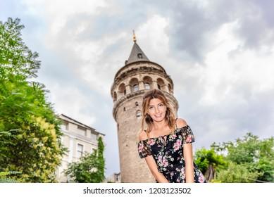 Portrait of beautiful woman with view of Galata tower in Beyoglu,Istanbul,Turkey
