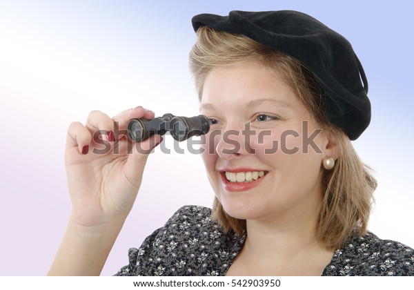 Portrait of a beautiful woman with vintage clothes and opera glasses