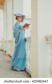 Portrait of a beautiful woman in a vintage dress