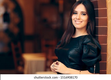Portrait of a Beautiful Woman Wearing Faux Leather Dress. Pretty party host wearing jewelry and trendy clothing
