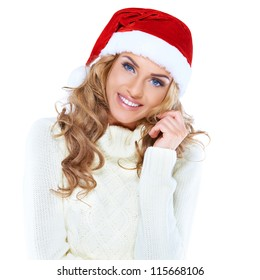 Portrait of a beautiful woman wearing a santa hat smiling
