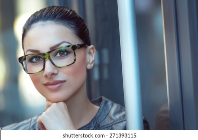 Portrait of beautiful woman wearing spectacles. Close up of young businesswoman, daylight - outdoors