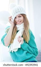 Portrait of a beautiful woman wearing woolen accessories