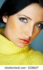Portrait of beautiful woman wearing yellow sweater