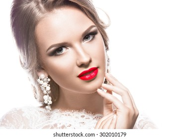 Portrait of a beautiful woman in a wedding dress in the image of the bride. Picture taken in the studio on a white background