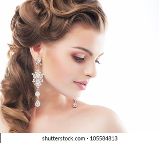 Portrait of Beautiful Woman Wedding Model Isolated on White Background. Advertising and Commercial Design. Shopping. Jewelry - Bridal Earrings, Hairstyle