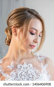 portrait of a beautiful woman in a white wedding dress with a beautiful make-up and hairstyle.
